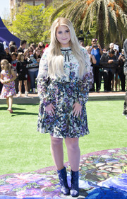 Meghan Trainor contrasted her sweet dress with edgy blue ankle boots by Rebecca Minkoff.