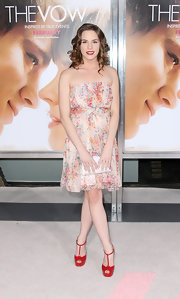 Christa paired her floral frock with bright red T-strap sandals.