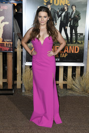 Abigail Breslin looked alluring in a plunging magenta gown by Jill Jill Stuart at the premiere of 'Zombieland Double Tap.'