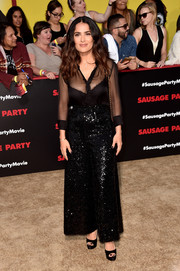 Salma Hayek's famous assets were on display in a sheer black Saint Laurent blouse at the premiere of 'Sausage Party.'