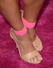 Cara Santana opted for a subtle touch of color with these nude and pink evening sandals.