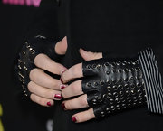 Marilyn Manson opted for his signature Gothic look with these fingerless studded gloves.