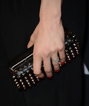 Katie Aselton added a bit of a rocker edge to her red carpet look with this studded clutch.