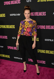 Katie Aselton added some feminine color to her red carpet look with this vibrant floral blouse.
