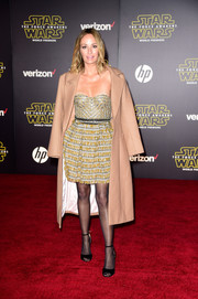 Catt Sadler arrived for the 'Star Wars: The Force Awakens' premiere sporting a beige House of CB coat over a strapless mini dress.