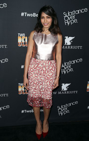 Freida Pinto went for high shine in a metallic pink top by Alexander Lewis during the premiere of 'Two Bellmen Two.'
