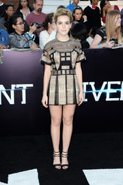 Kiernan Shipka looked exotic (and oh-so-cute) at the 'Divergent' premiere in an embroidered gold and black Valentino romper with a mini skirt overlay.