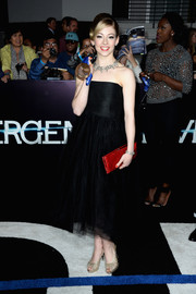 Gracie Gold added a lovely pop of color with a red satin clutch.