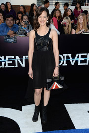 Brina Palencia added an extra dose of toughness with a pair of black mid-calf boots.