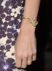 "Naomi Watts accessorized with a diamond, lizard-shaped bracelet at the L.A. premiere of ""The Impossible."""