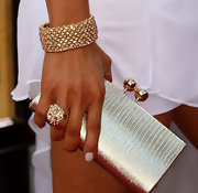 Actress Lorena Rincon showed off her metallic buckled clutch, which she paired with sparkling jewels.