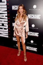 Kara Del Toro cut a seductive figure in a cleavage-and-leg-baring satin wrap dress at the premiere of 'Mechanic: Resurrection.'