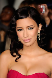Christian Serratos wore a pair of Shonna Drew 14-carat yellow gold with diamond earrings at the premiere of 'The Twilight Saga: Breaking Dawn Part 1.'