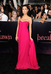 Christian Serratos was a stand-out on the red carpet in a breathtaking hot pink gown. The strapless Grecian style dress draped behind her for a modern ethereal look. A gold clutch and shining retro waves were the starlet's finishing touches.