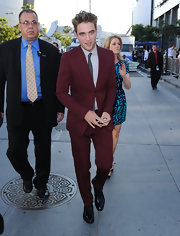Robert looked dapper in a tailored burgundy suit with tuxedo oxfords and his signature tousled hairstyle.
