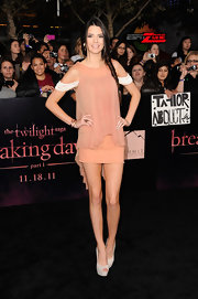 Kendall Jenner showed off her long stems in a peach cocktail dress at the 'Twilight' premiere.