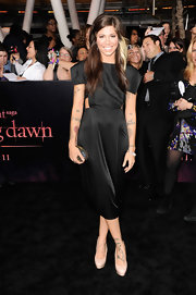 Nude platform pumps kept Christina's premiere look clean and stylish.