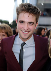 The hunky actor sported his signature messy style with a burgundy suit.