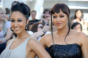 Tia Mowry styled her hair in a sleek ponytail while blunt cut bangs framed her face.