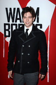 Jackson Rathbone's not afraid to take fashion risks with a double pointed blazer with gray trim.