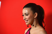 Christian Serratos pulled her curled locks up into a high ponytail for the 'Warm Bodies' premiere.