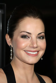 Erica Durance attended the premiere of 'Tim and Eric's Billion Dollar Movie' wearing smoky brown and gray shadows with pearly white highlights.
