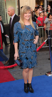 Ashley wears a bright and sparkling geometric print cocktail dress with ankle boots at the premiere of 'Gnomeo and Juliet.'