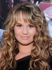 Debby Ryan gave her look a boost with shimmering lip gloss. A thick liner on her upper lids completed her look.