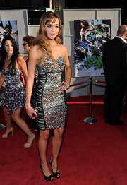 Sharni Vinson completed her sparkling red carpet look with these patent, peep toe slingbacks.  Vinson stars in Blue Crush 2.