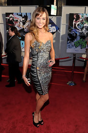Sharni looked stunning in a crystal-covered cocktail dress with ruched side panels that accentuated her curves.
