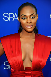 Tika Sumpter sported pale lips when she attended the 'Sparkle' premiere. Her neutral-toned lipstick provided a stark contrast to her heavy eye makeup. It was a very eye-catching beauty look overall.