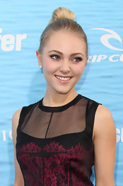 Annasophia attended the premiere of 'Soul Surfer' with an elegant twisted bun at the crown.