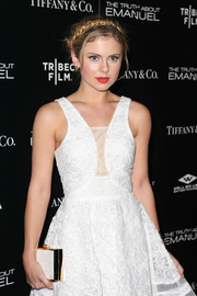 Rose McIver carried a super-elegant white and gold box clutch by Inge Christopher when she attended the premiere of 'The Truth About Emanuel.'