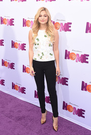 Olivia Holt polished off her sleek ensemble with a pair of bronze pumps.