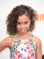 Asia Monet Ray sported a shock of curls at the premiere of 'Home.'
