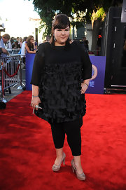 Ashley Fink donned a black tunic dress with petal chiffon layers for the 'Glee' concert movie premiere.
