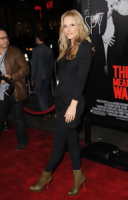 Monet topped off her red carpet ensemble with olive green leather ankle boots.
