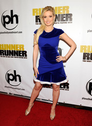 Holly Madison chose a cobalt cocktail dress with velvet insets for her 'Runner Runner' red carpet look.