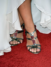 Gina Carano's silver strappy heels looked lovely when paired with her flowing gown.