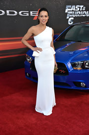 Michelle Rodriguez showed off her toned arms with this one-shoulder white gown that featured peplum detailing at the hips.
