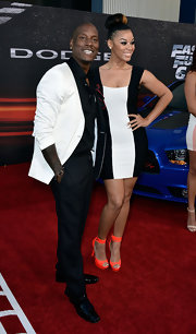 Tyrese Gibson rocked a black and white look when he sported this black suit with a white blazer at the premiere of 'Fast and Furious 6.'