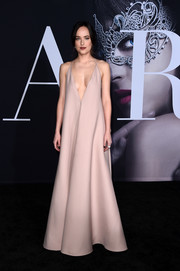 Dakota Johnson's blush-colored deep-V halter gown at the 'Fifty Shades Darker' premiere was a perfect blend of sexy and elegant!