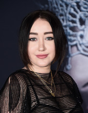 Noah Cyrus adorned her black outfit with layers of gold necklaces by Roseark.
