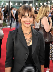 Rashida wore layered silver chains, and sparkly crystals, to add some pizazz to her red carpet look.