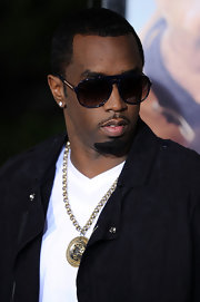 Diddy pulls of rocking shades at night. The mogul looked stylish in navy aviator sunglasses while walking the red carpet.