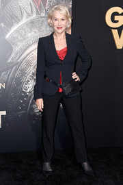Helen Mirren completed her simple ensemble with a pair of black trousers.
