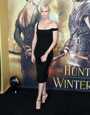 Charlize Theron complemented her dress with classic black ankle-strap pumps by Christian Louboutin.