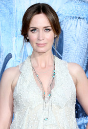 Emily Blunt attended the premiere of 'The Huntsman: Winter's War' wearing layers of turquoise and diamond necklaces.