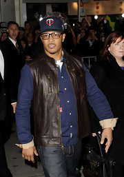 T.I. dressed up jeans and a button down with this leather vest at the premiere of 'Identity Theft.'