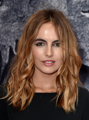 Camilla Belle went for edgy styling with this tousled wavy 'do at the 'Jurassic World' premiere.